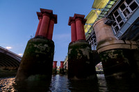Pillars that formed part of the original railway bridge at Blackfriars. River Thames, London