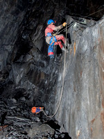 Peter Hamilton doing the short abseil to reach the bottom of the mine workings. Gaewern Slate Mine.