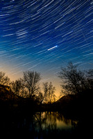 Star trails over the River Ceou, France