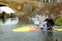 Neil Montgomery 'seal launching' onto the River Thames at Tadpole Bridge. Oxfordshire.