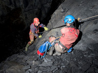 Neil Montgomery (left) prussiking in Gaewern Slate Mine. Peter Hamilton (right)