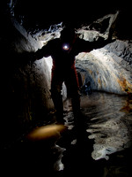 Caver Neil Montgemery in the tunnel entrance to Gaewern Slate Mine. North Wales, UK