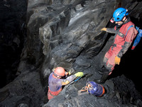 "Caver Neil Montgomery (left) climbing down the ""sling ladder"" with  Peter Hamilton (right)"