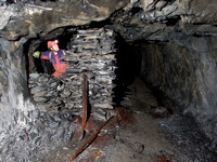 Neil Montgomery inside the small stone, walled hut, Gaewern Slate Mine. North Wales, UK