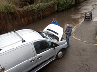 High water on the River Thames.   A car drowns outside the White Swan Pub - Twickenham, London.