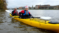Canoeists float their boats for Christmas Dinner