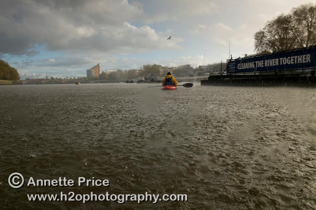Hail stones landing on the River Thames, Putney, London.