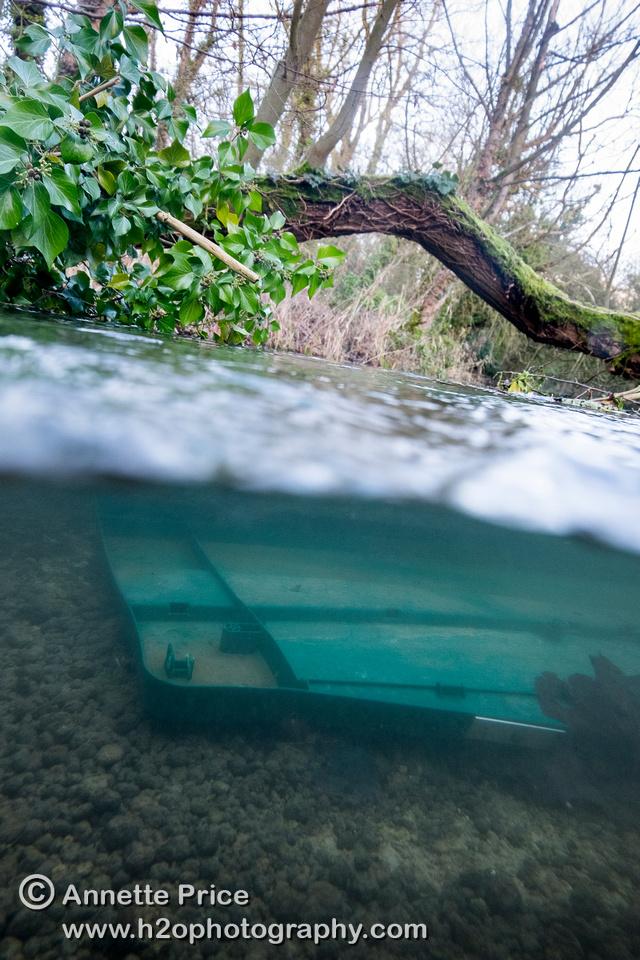 Junk underwater. River Thames, near Ashton Keynes village, UK