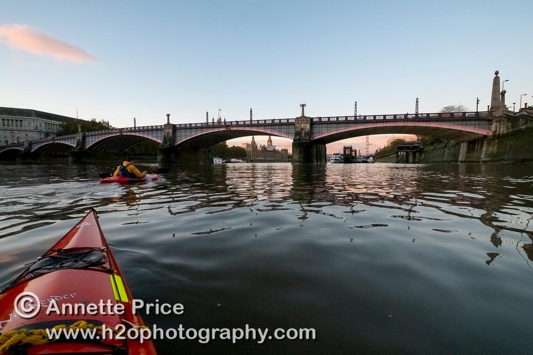 Kayaks approaching Lambeth Bridge. River Thames, London.