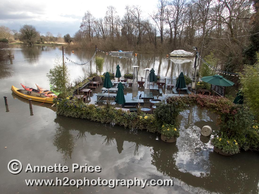 High water on the River Thames. White Swan Pub - Twickenham, London.