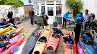 Kayaks parked in the beer garden at the Ship pub, while their owners enjoy Christmas Dinner.