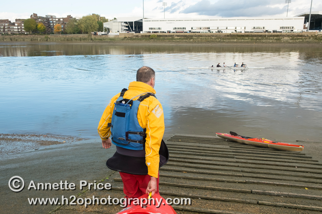 Carrying the kayaks to the water.  River Thames, Barn Elms, London